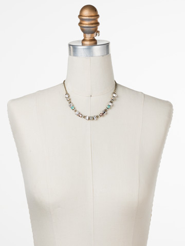 Goldenrod Necklace in Antique Gold-tone White Magnolia displayed on a necklace bust