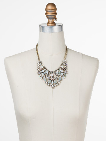 Azalea Necklace in Antique Gold-tone White Magnolia displayed on a necklace bust