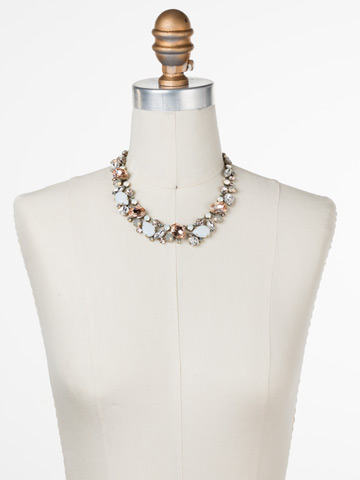 Bluebell Necklace in Antique Gold-tone White Magnolia displayed on a necklace bust