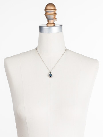 Embellished Rivoli Necklace in Antique Silver-tone Glory Blue displayed on a necklace bust