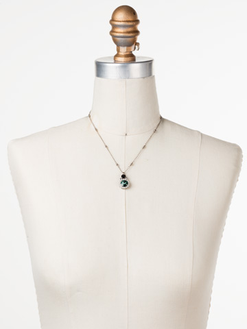 Embellished Rivoli Necklace in Antique Silver-tone Game Day Green displayed on a necklace bust