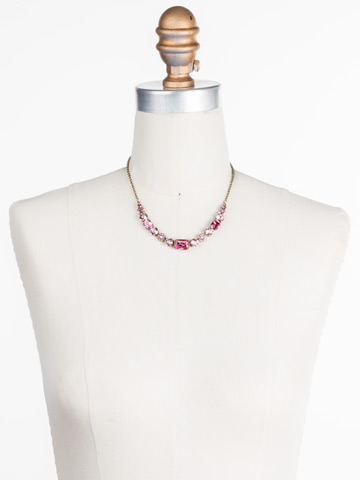 Dietes Necklace in Antique Gold-tone Pink Passion displayed on a necklace bust