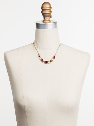 Datura Necklace in Antique Gold-tone Go Garnet displayed on a necklace bust