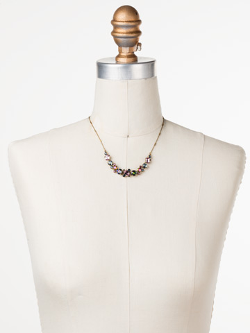 Datura Necklace in Antique Gold-tone Royal Plum displayed on a necklace bust