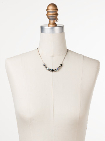 Datura Necklace in Antique Silver-tone Black Tie displayed on a necklace bust