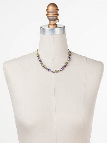 One-of-a-Kind Necklace in Antique Gold-tone Wildflower displayed on a necklace bust