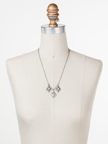 Love Tri-Angle Necklace in Antique Silver-tone Crystal displayed on a necklace bust
