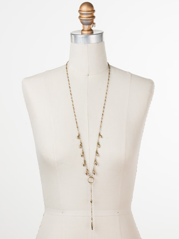 Stand Out Necklace in Antique Gold-tone Crystal displayed on a necklace bust