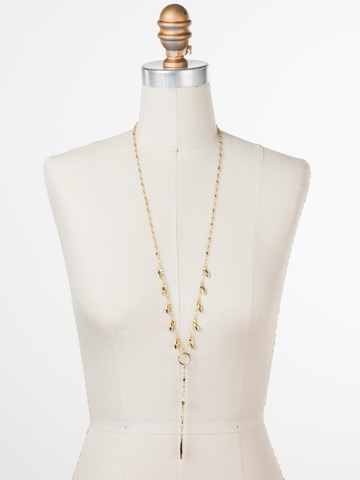 Stand Out Necklace in Bright Gold-tone Crystal displayed on a necklace bust