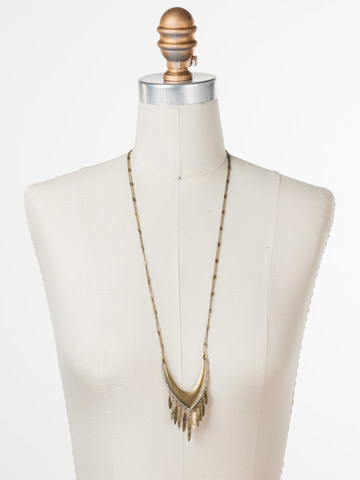 Ruffled Feathers Necklace in Antique Gold-tone Crystal displayed on a necklace bust