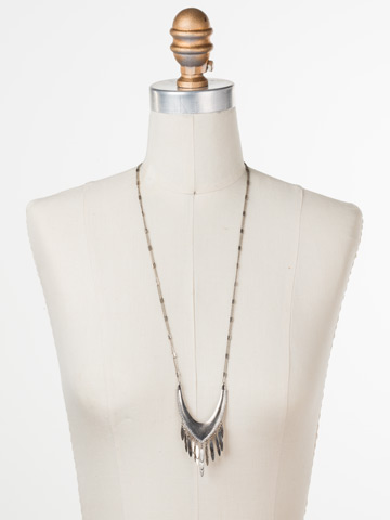 Ruffled Feathers Necklace in Antique Silver-tone Crystal displayed on a necklace bust