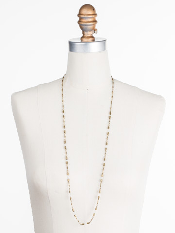 Chained To the Rhythm Necklace in Antique Gold-tone Crystal displayed on a necklace bust