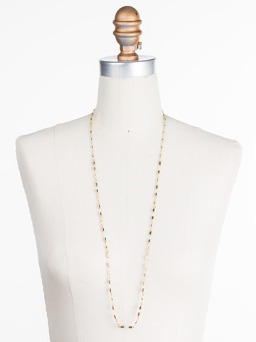 Chained To the Rhythm Necklace in Bright Gold-tone Crystal displayed on a necklace bust