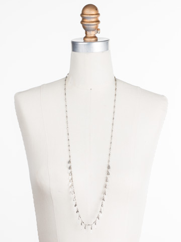 Dangling Medallions Necklace in Antique Silver-tone Crystal displayed on a necklace bust