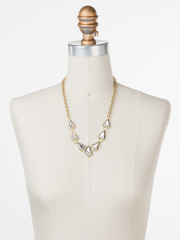 On the Rocks Necklace in Bright Gold-tone Crystal displayed on a necklace bust