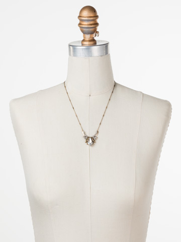 Perfect Symmetry Necklace in Antique Gold-tone Crystal displayed on a necklace bust