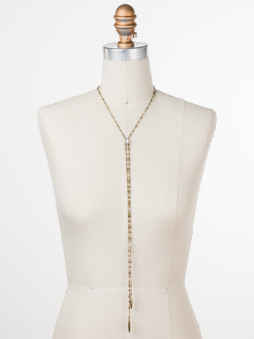 Strung Together Necklace in Antique Gold-tone Crystal displayed on a necklace bust