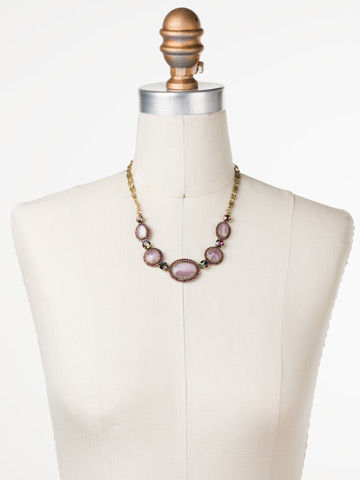 Ballota Necklace in Antique Gold-tone Royal Plum displayed on a necklace bust