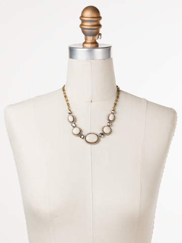 Ballota Necklace in Antique Gold-tone Sandstone displayed on a necklace bust