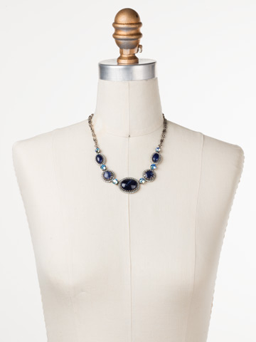 Ballota Necklace in Antique Silver-tone Blue Suede displayed on a necklace bust
