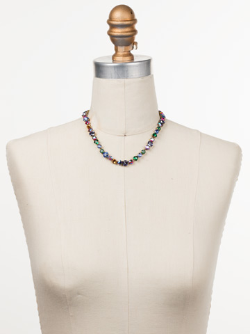 Sedge Necklace in Antique Gold-tone Game of Jewel Tones displayed on a necklace bust