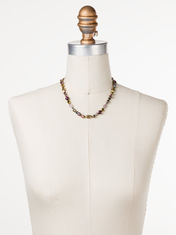 Toyon Necklace in Antique Gold-tone Royal Plum displayed on a necklace bust