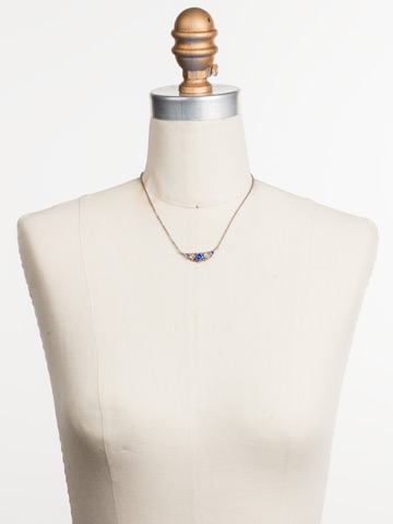 Aralia Delicate Pendant Necklace in Antique Silver-tone Orange Crush displayed on a necklace bust