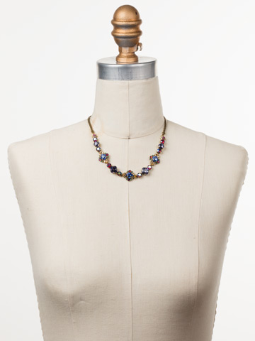 Stonecrop Necklace in Antique Gold-tone Game of Jewel Tones displayed on a necklace bust