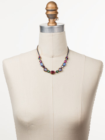 Cardoon Classic Line Necklace in Antique Gold-tone Game of Jewel Tones displayed on a necklace bust