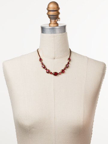 Cardoon Classic Line Necklace in Antique Gold-tone Sansa Red displayed on a necklace bust