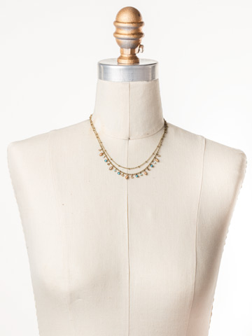 Rina Delicate Necklace in Antique Gold-tone Driftwood displayed on a necklace bust