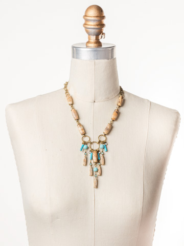 Sarita Statement Necklace in Antique Gold-tone Driftwood displayed on a necklace bust