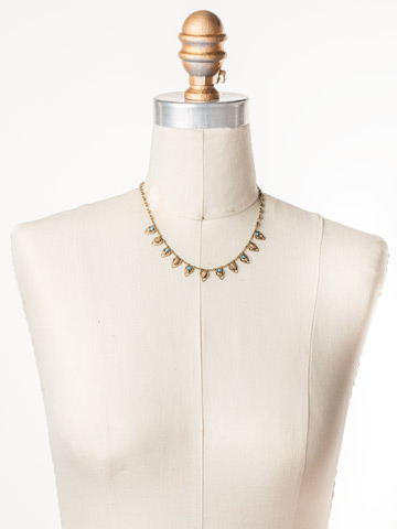 Lavanda Petite Bib Necklace in Antique Gold-tone Driftwood displayed on a necklace bust