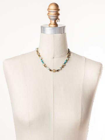 Chiara Line Necklace in Antique Gold-tone Driftwood displayed on a necklace bust
