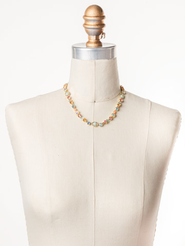 Chiara Line Necklace in Bright Gold-tone Mango Tango displayed on a necklace bust