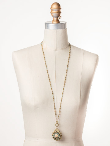 Idalia Statement Pendant Necklace in Antique Gold-tone Driftwood displayed on a necklace bust