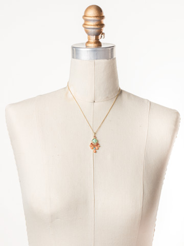 Edda Pendant Necklace in Bright Gold-tone Mango Tango displayed on a necklace bust