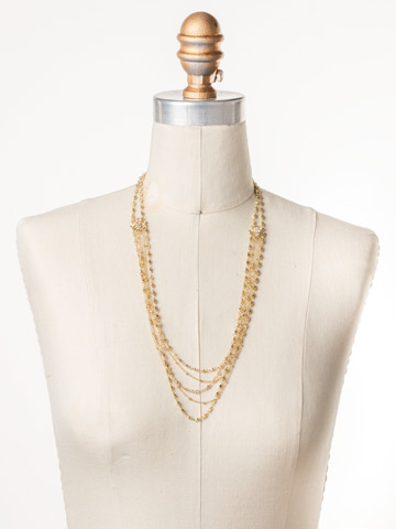 Lelia Long Strand Necklace in Bright Gold-tone Mango Tango displayed on a necklace bust