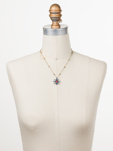 Celestina Pendant Necklace in Antique Gold-tone Bohemian Bright displayed on a necklace bust