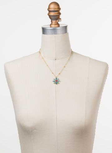 Celestina Pendant Necklace in Bright Gold-tone Candy Pop displayed on a necklace bust