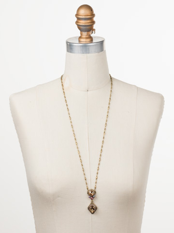 Giulia Pendant Necklace in Antique Gold-tone Beach Comber displayed on a necklace bust