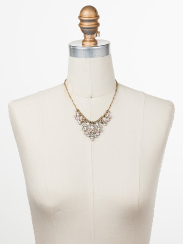Sicily Statement Necklace in Antique Gold-tone Snow Bunny displayed on a necklace bust