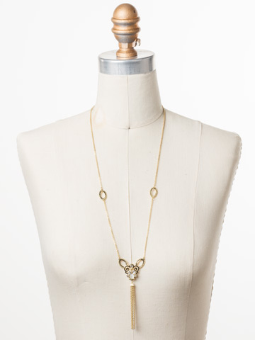 Cosette Long Strand Necklace in Bright Gold-tone Polished Pearl displayed on a necklace bust