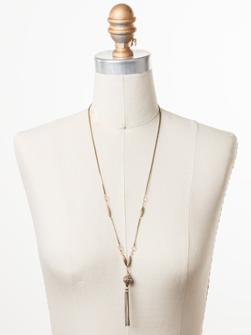 Constantia Long-Strand Necklace in Antique Gold-tone Beach Comber displayed on a necklace bust