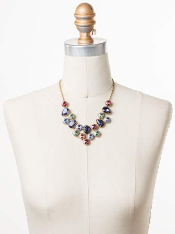 Armina Necklace in Antique Gold-tone Bohemian Bright displayed on a necklace bust
