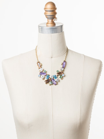Fabiana Necklace in Antique Gold-tone Bohemian Bright displayed on a necklace bust