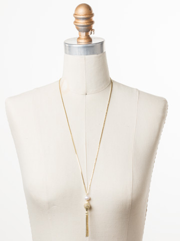 Marvella Long Strand Necklace in Bright Gold-tone Polished Pearl displayed on a necklace bust