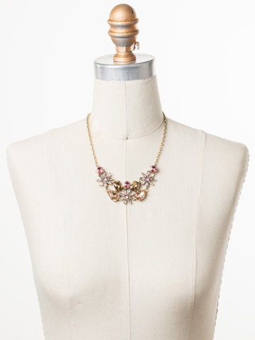 Alessia Necklace in Antique Gold-tone Beach Comber displayed on a necklace bust