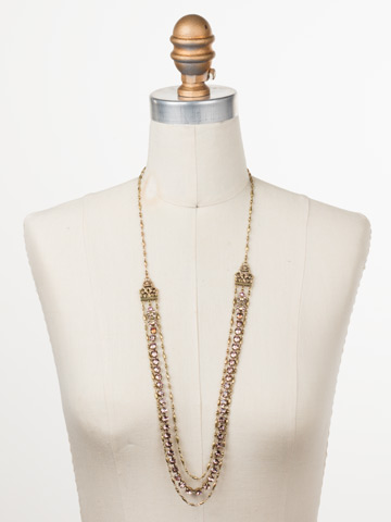 Petronilla Long Strand Necklace in Antique Gold-tone Beach Comber displayed on a necklace bust