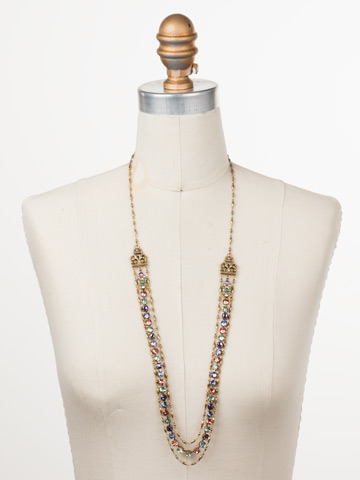 Petronilla Long Strand Necklace in Antique Gold-tone Bohemian Bright displayed on a necklace bust